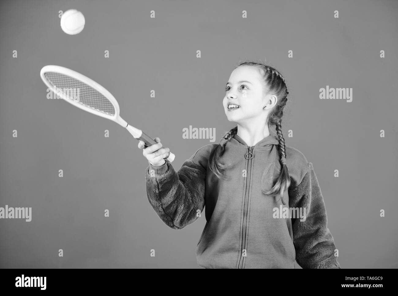 Tennis player with racket and ball. Little teen girl. Fitness diet brings health and energy. Happy child teen girl play tennis. Sport game success. Gym workout of teen girl. teen girl practice skills. - Stock Image