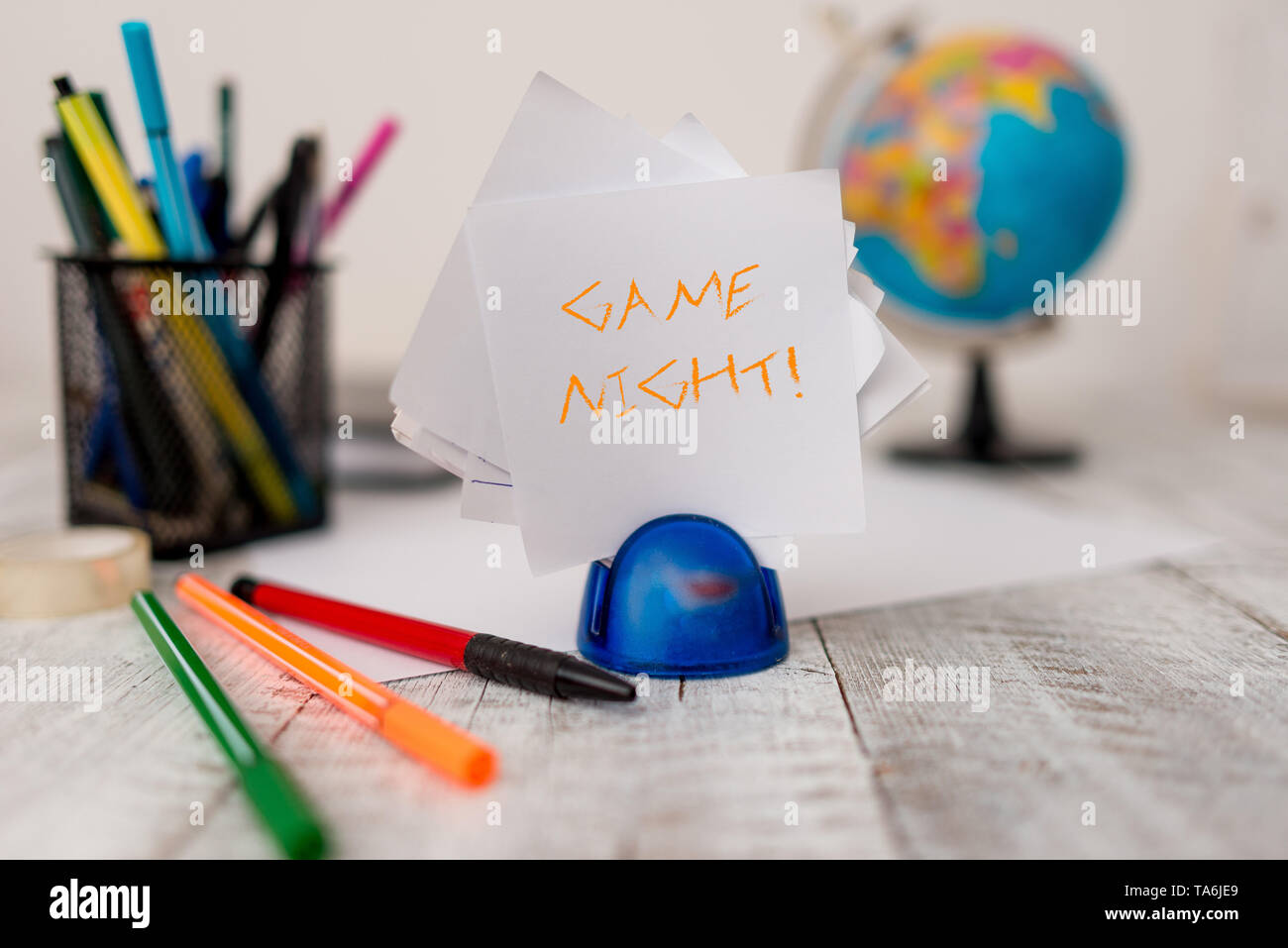 Text sign showing Game Night. Business photo showcasing usually its called on adult play dates like poker with friends Stationary plus pens and papers - Stock Image