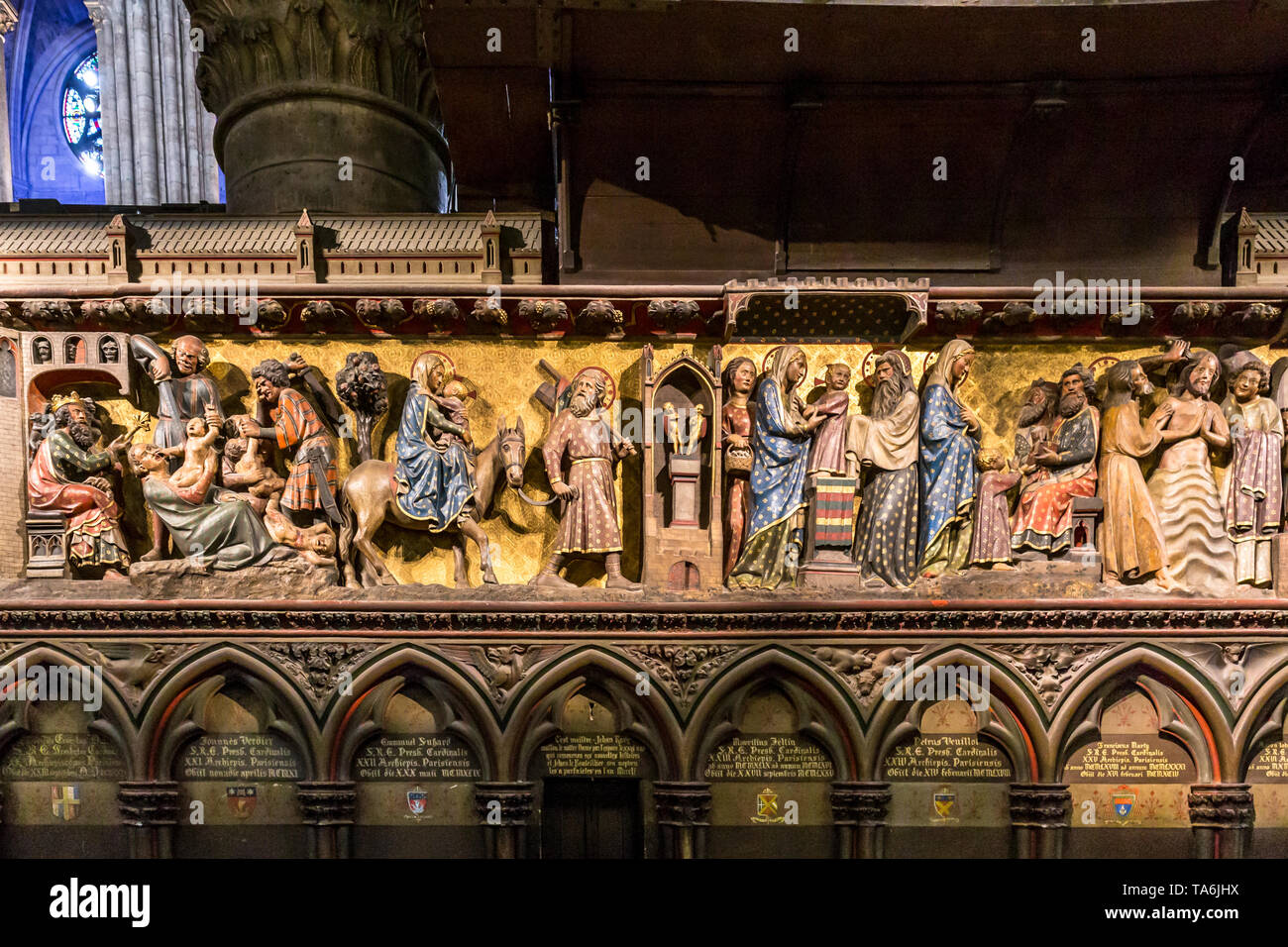 14th Century wood reliefs in Notre-Dame de Paris Cathedral telling the story of the life of Jesus Christ. Memorials to various Cardinals are shown - Stock Image