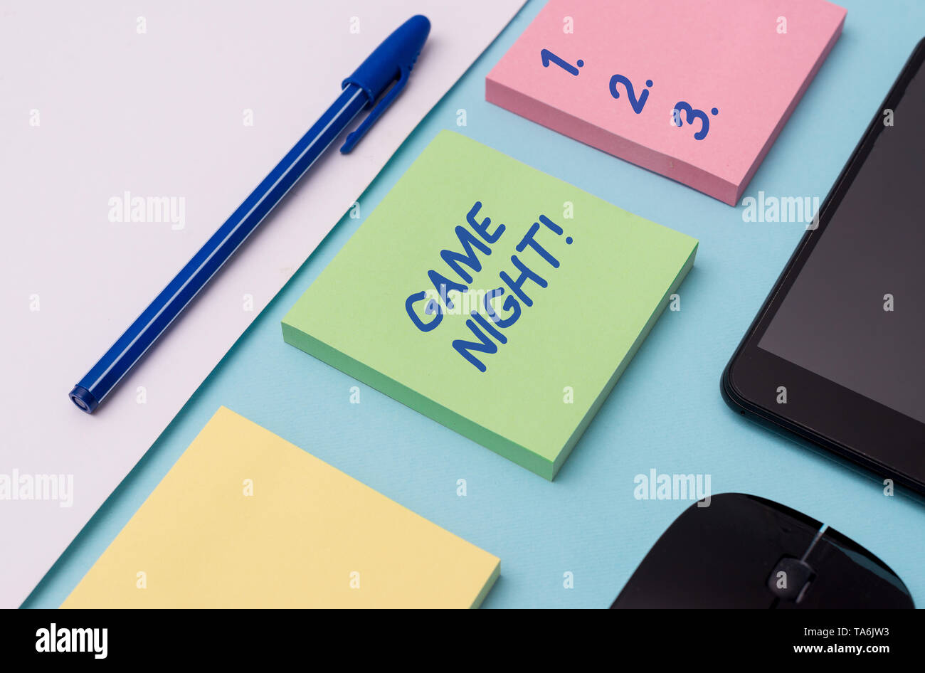 Handwriting text writing Game Night. Conceptual photo usually its called on adult play dates like poker with friends Note papers and stationary plus g - Stock Image