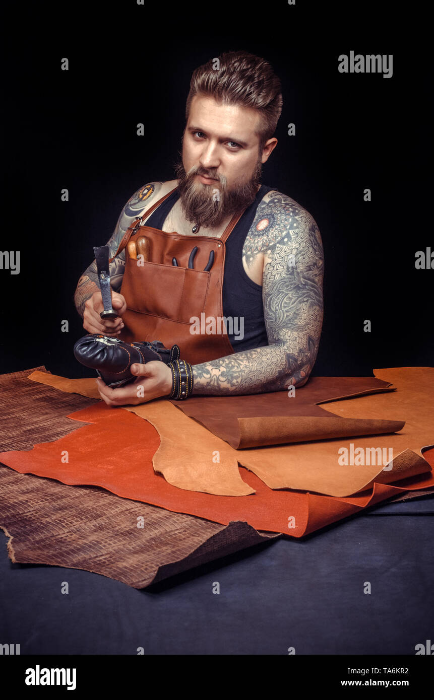 Professional Leather Worker working as artisan  - Stock Image