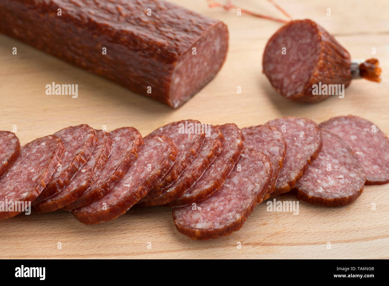 Polish wyborne salami cut into slices - Stock Image