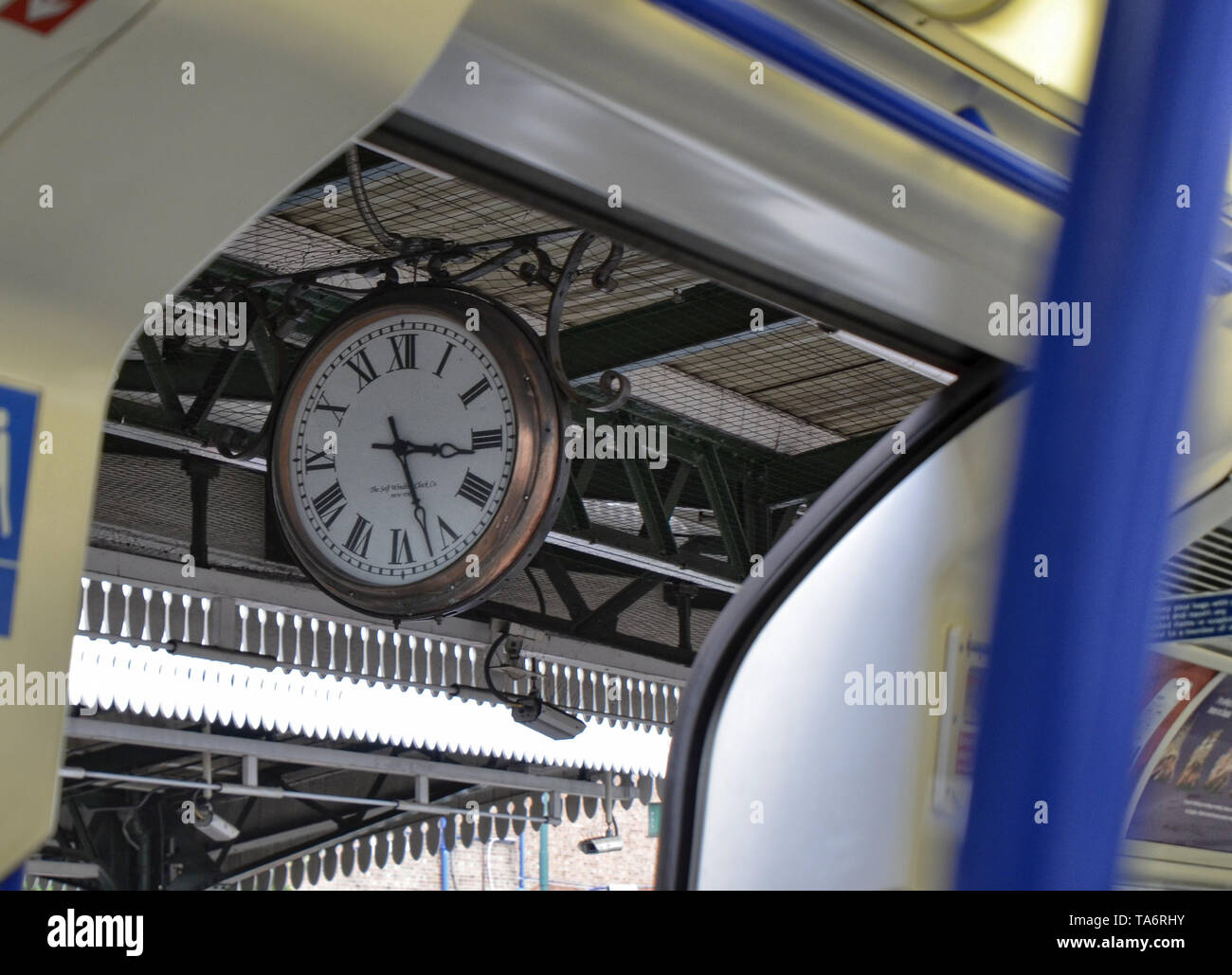 London, United Kingdom, June 14 2018. A vintage symbol of London: the clock with hands visible in almost all metro stops. With its retro look, it stan - Stock Image