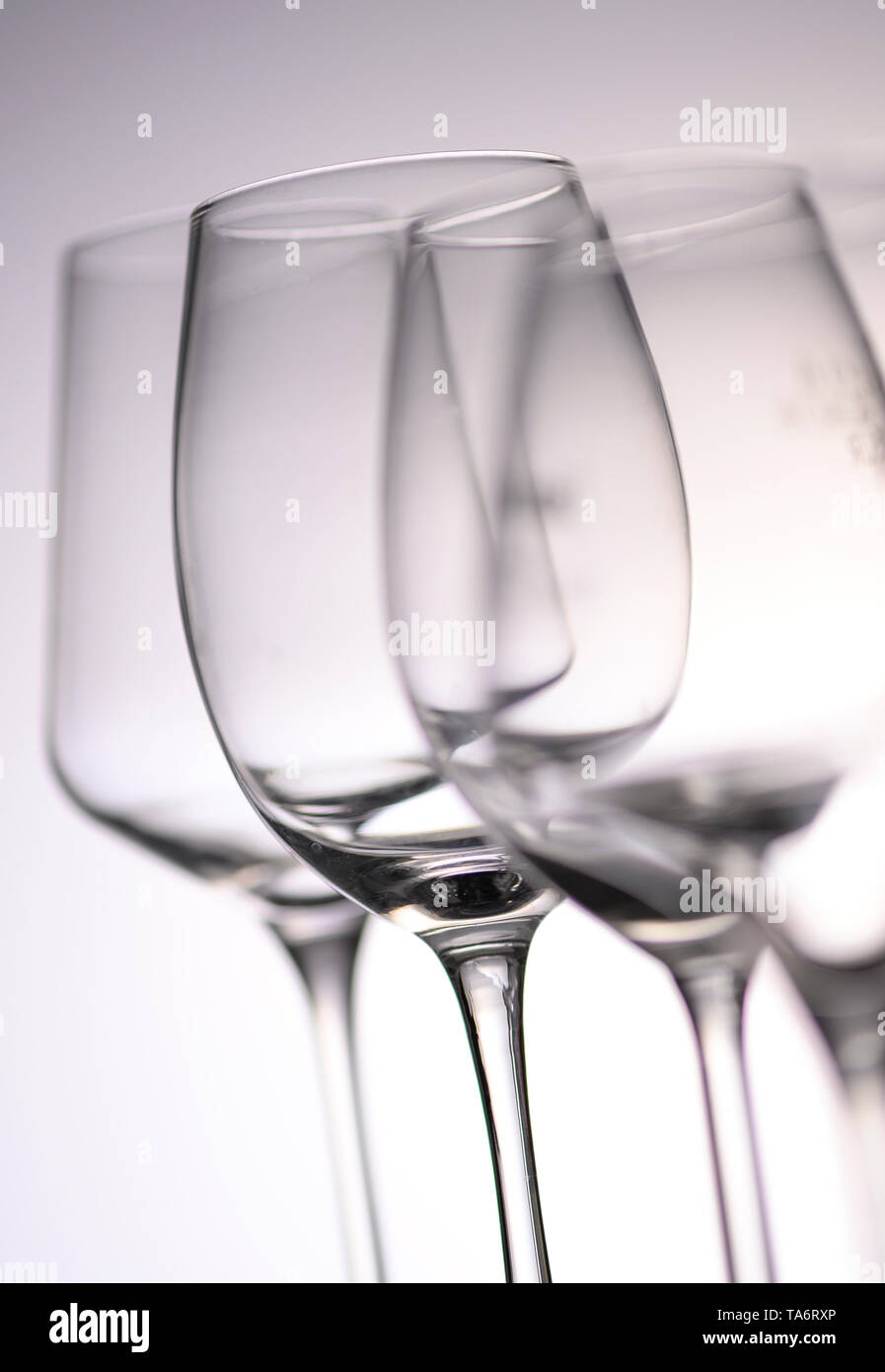 Empty Wine Glasses on white and grey background, France - Stock Image