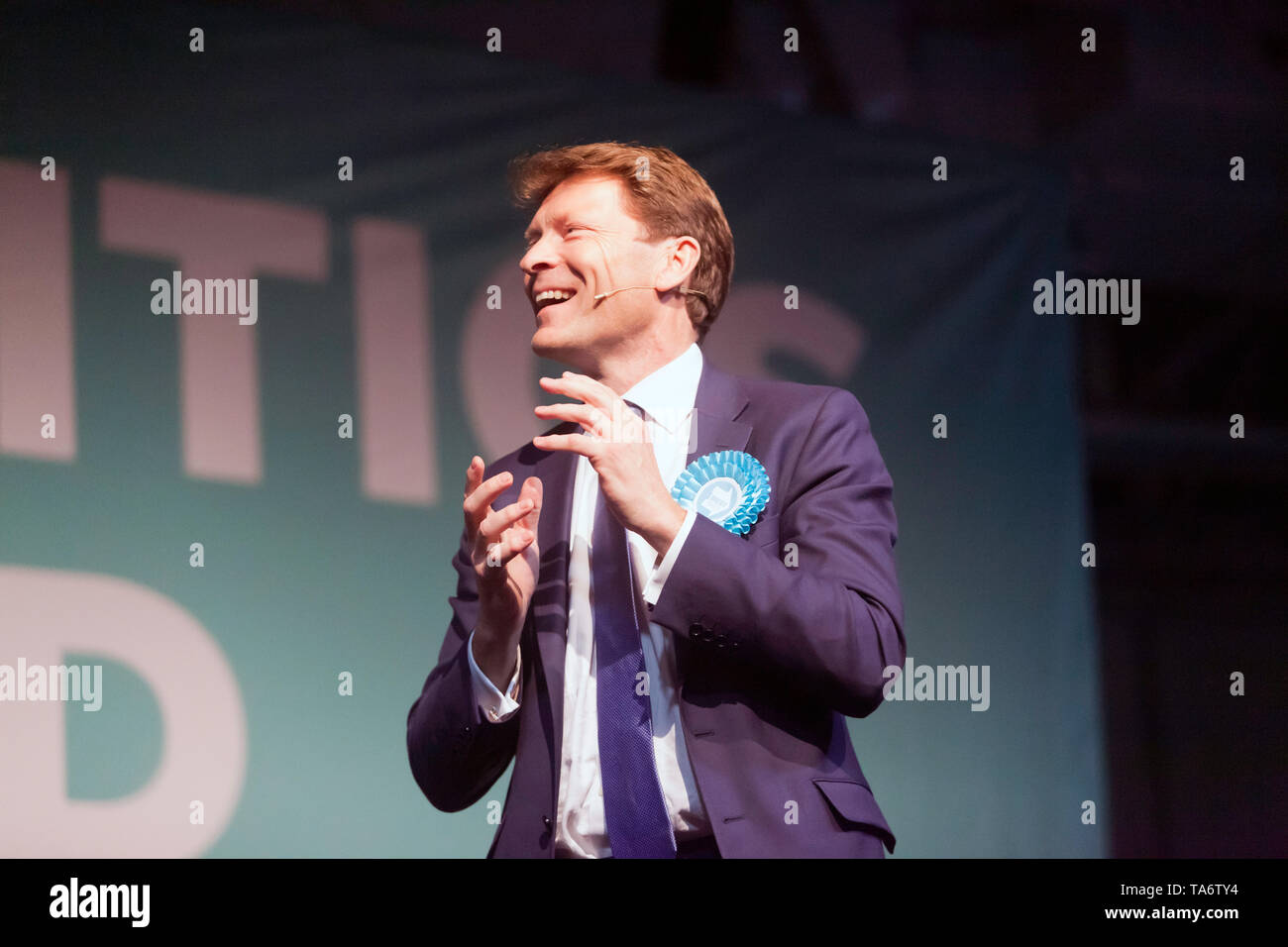 Richard Tice, Chairman of The Brexit Party, introducing the speakers, during a Political Rally held at Olympia London Stock Photo