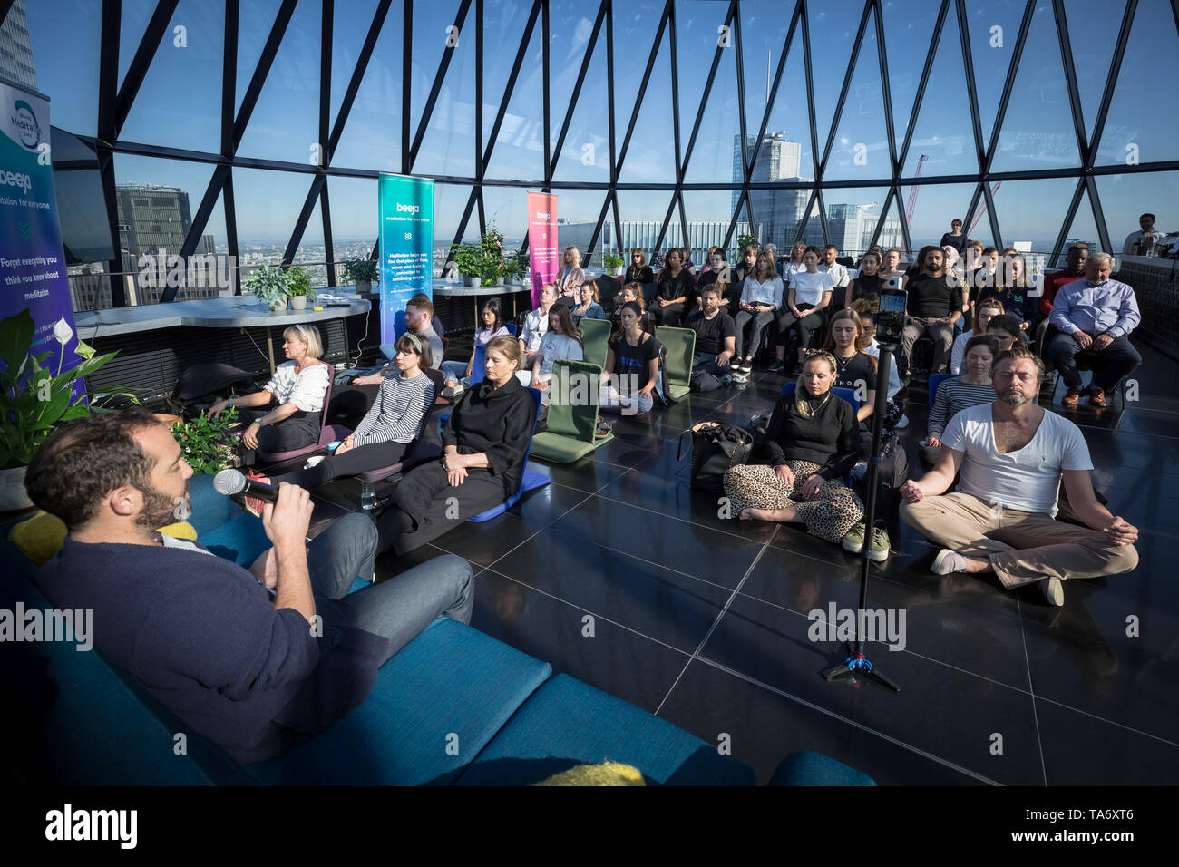 World Meditation Day performed at the top of The Gherkin building led by meditation guru Will Williams(pictured). London, UK. Stock Photo