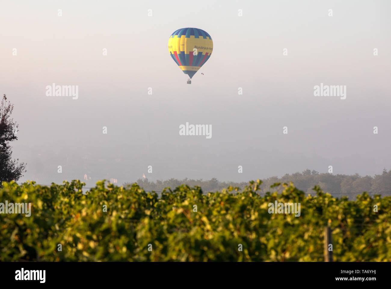 Saint Emilion, France - September 10, 2018: Air balloon flying in the morning over the vineyards near Saint Emilion. Gironde, France - Stock Image