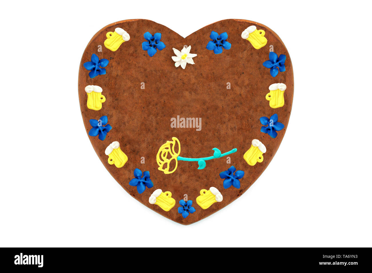 Oktoberfest Gingerbread heart cookie with ornaments and copy space. Oktoberfest is a october fest in munich germany for beer and bavarian food. - Stock Image