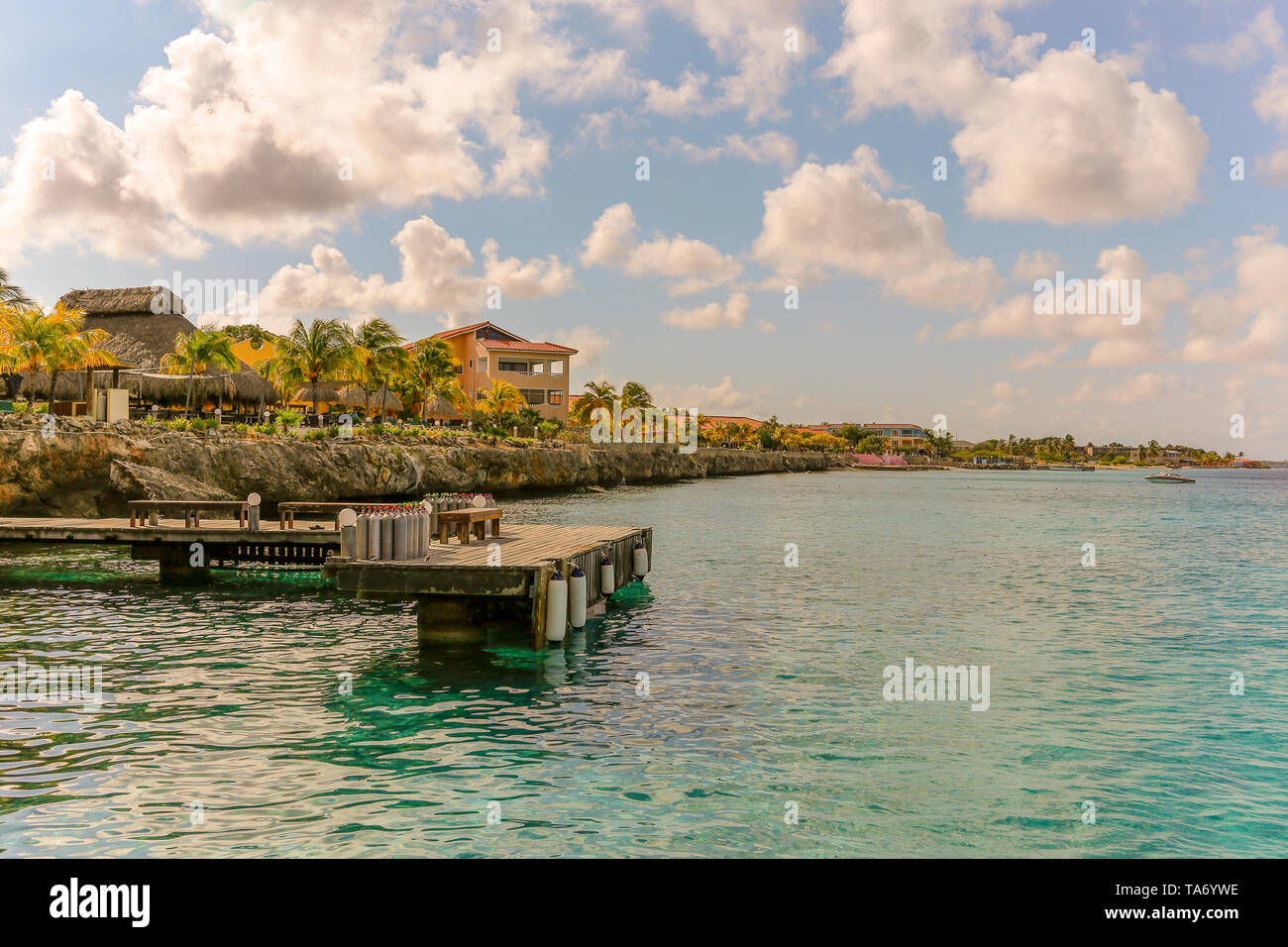 Pier with diving air tanks ready for divers - view back onto dive resort - copy space - Stock Image