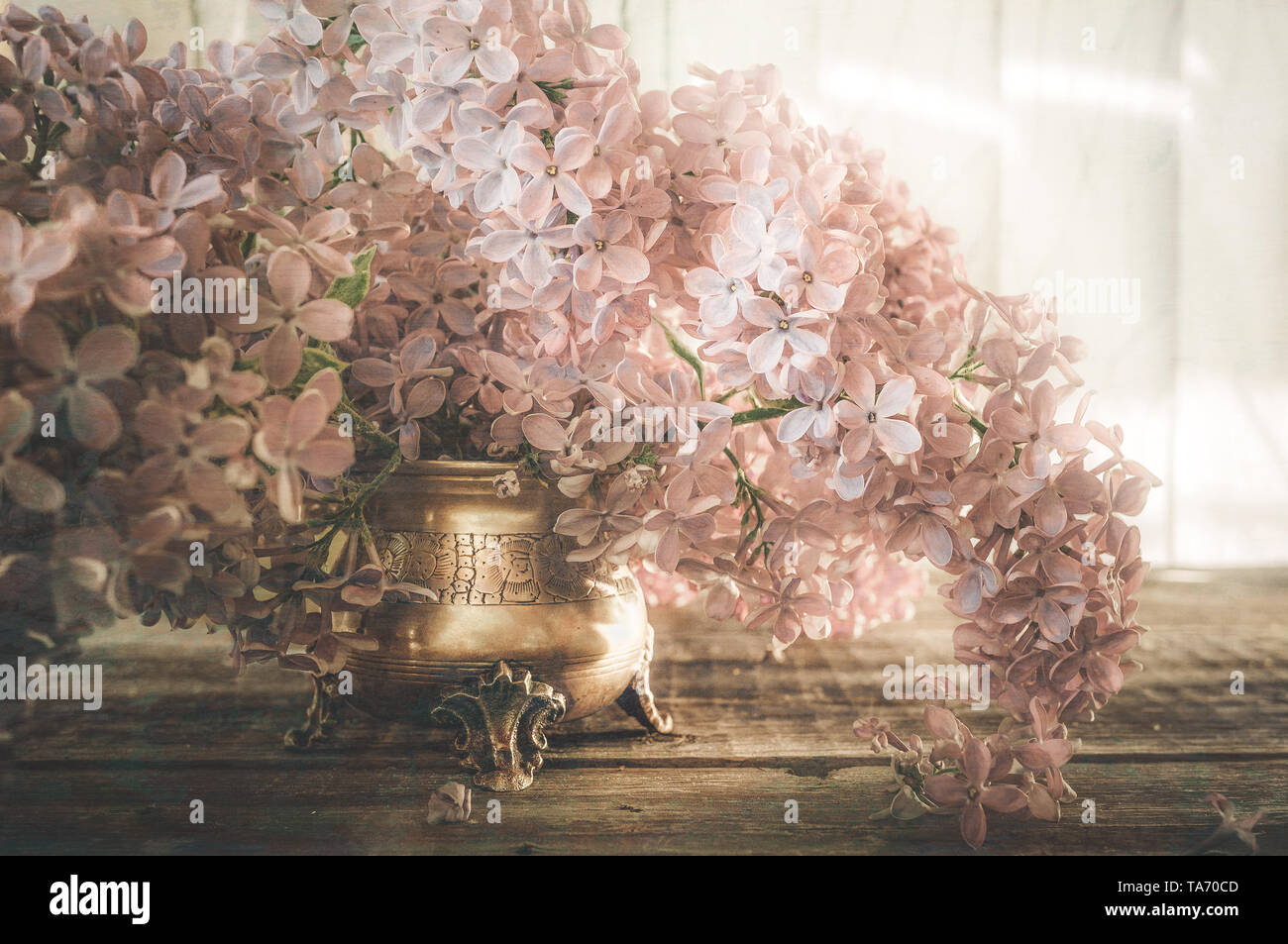 Beautiful bouquet of lilacs on the table in the raindrops. Retro look. Copy space. Art. - Stock Image
