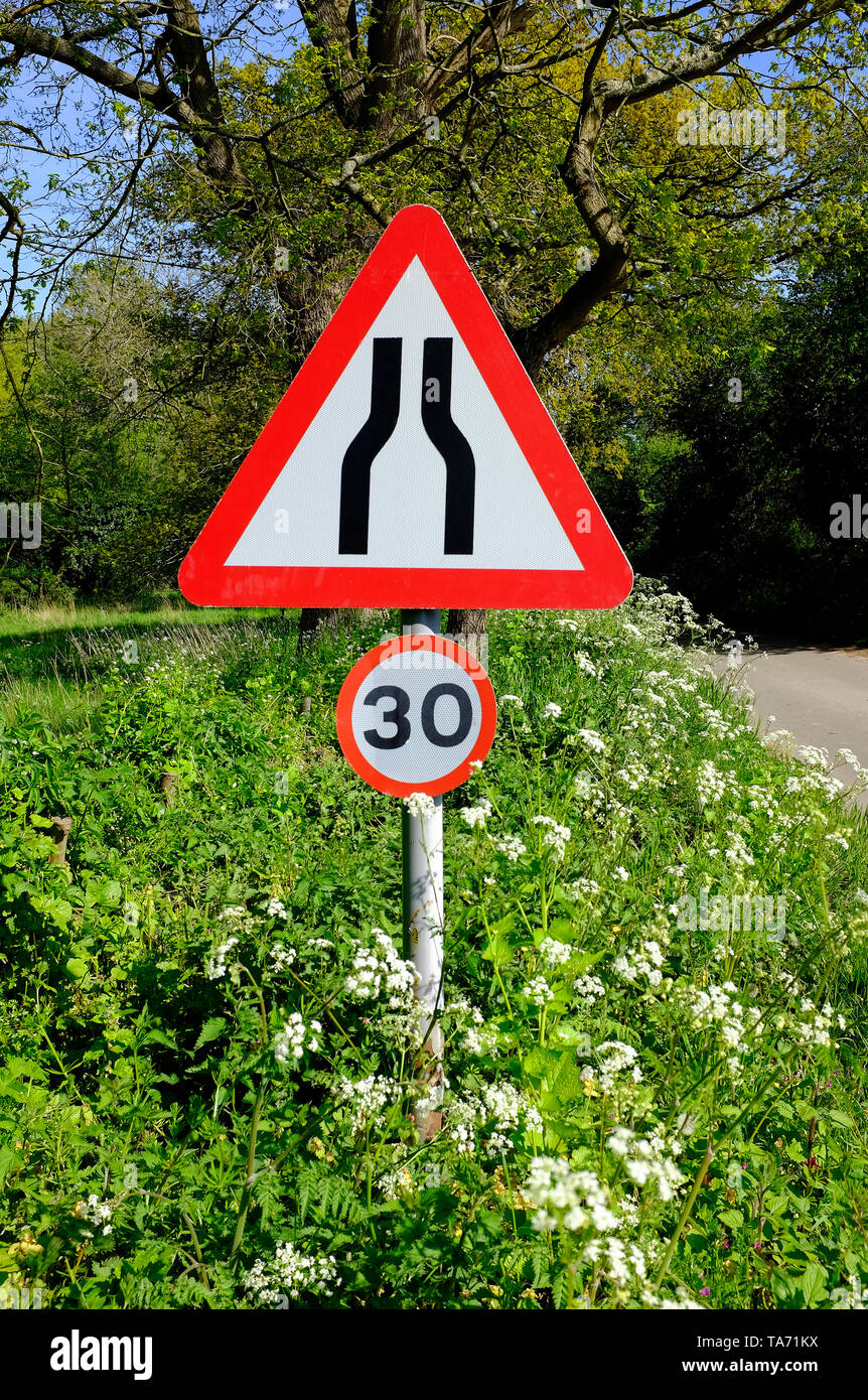 road narrows road sign and 30mph speed limit signs, north norfolk, england - Stock Image