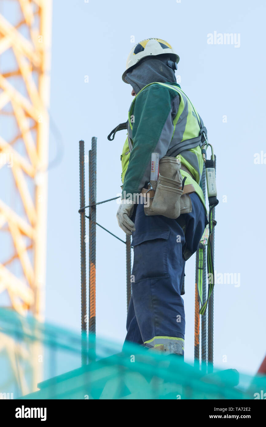 An engineer were walking up the stairs to survey the construction site, Engineering Safety Concept. Stock Photo