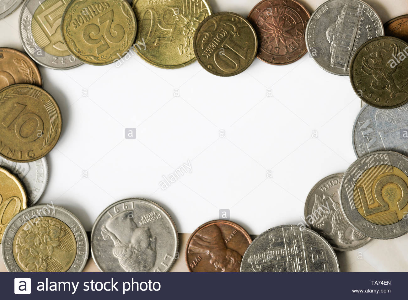 Coins of different countries removed from the top with a white field for posting information - Stock Image