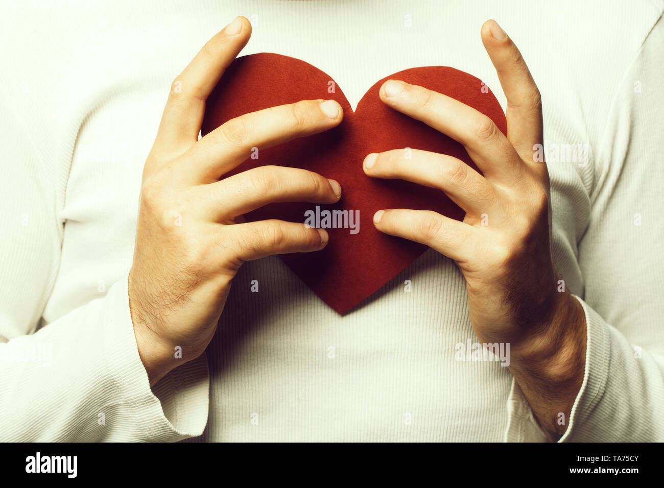 romantic man with paper heart Stock Photo