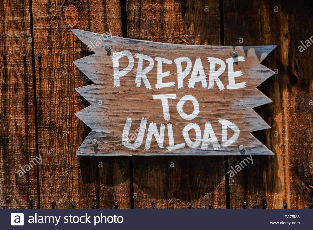 Prepare to unload painted wooden sign - Stock Image