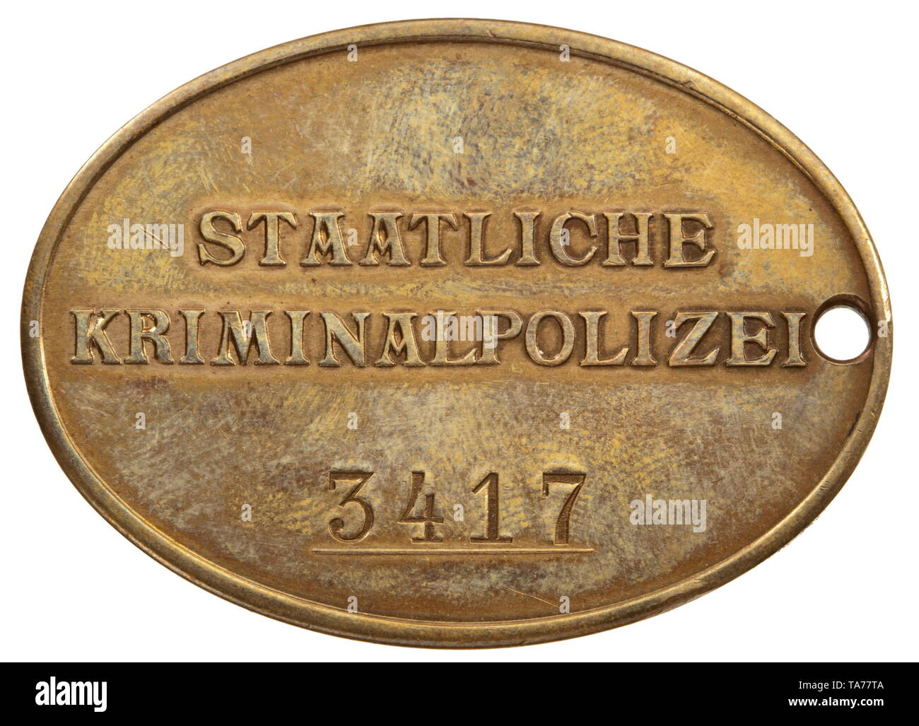 An identification badge of the national criminal police Bronze and non-ferrous metal, with national eagle embossed on the front. The reverse with embossed inscription 'STAATLICHE KRIMINALPOLIZEI' (tr. 'national criminal police') and struck number '3417' above a raised line. Dimensions circa 51 x 37.2 mm. Weight 29.6 g. Comes with a blueprint concerning retirement issued to a detective chief constable. historic, historical, 20th century, Additional-Rights-Clearance-Info-Not-Available - Stock Image