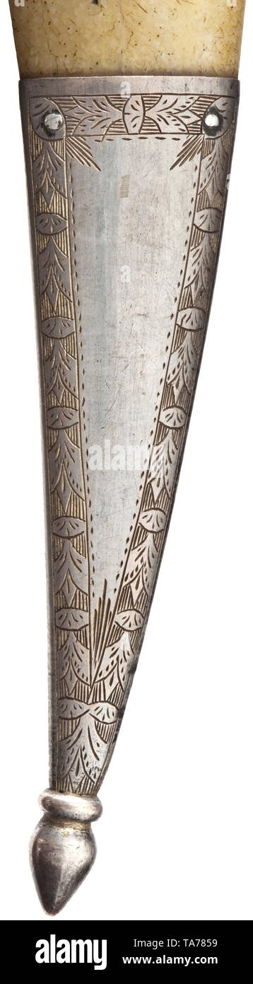 An Ottoman khanjar with walrus ivory hilt and scabbard, circa 1800 Double-edged blade of wootz-Damascus with a medial ridge on each side. The massive hilt and the scabbard made in one piece of crystalline walrus ivory. The scabbard with a silver suspension loop and florally engraved chape. Small defect and lateral shrinkage cracks on the body of the scabbard. Length 43.8 cm. historic, historical, Ottoman, Orient, Oriental, Asia, Asian, 19th century, Additional-Rights-Clearance-Info-Not-Available Stock Photo