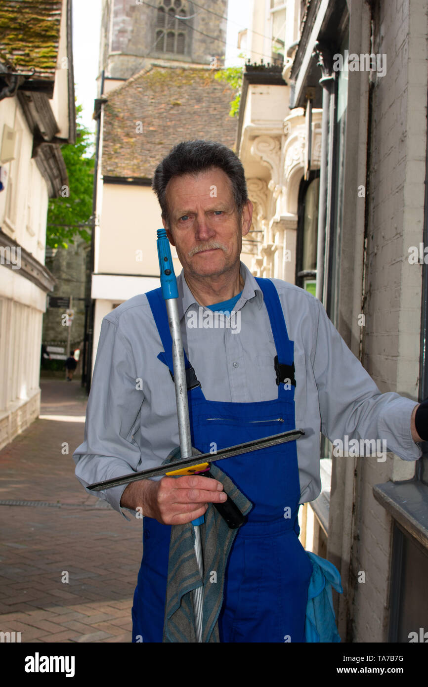 Window Cleaner at the Ashford Highstreet - Stock Image