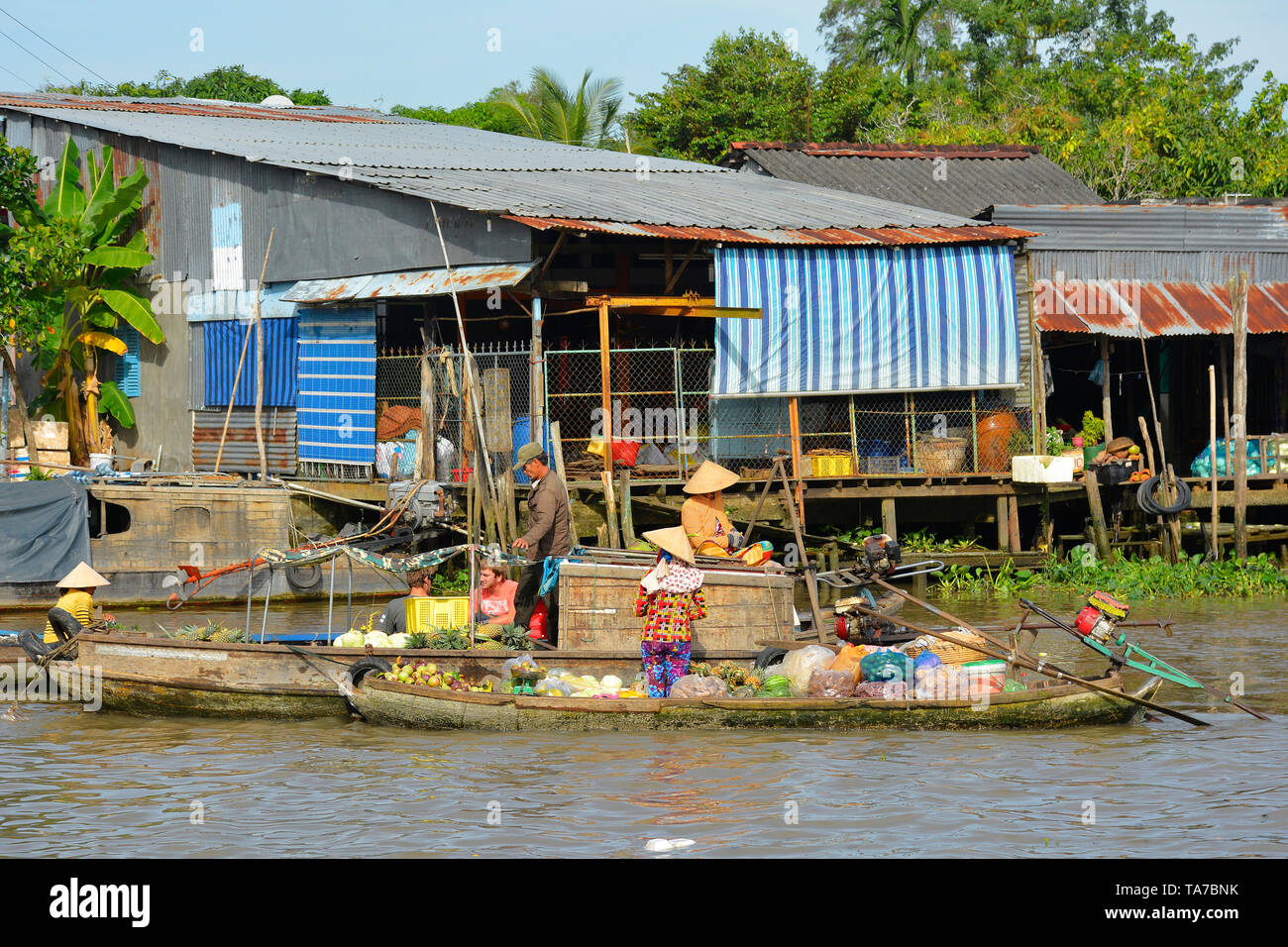 Phong Dien, Vietnam - December 31st 2017. Local vendors on the river at the Phong Dien Floating Market near Can Tho in the Mekong Delta - Stock Image