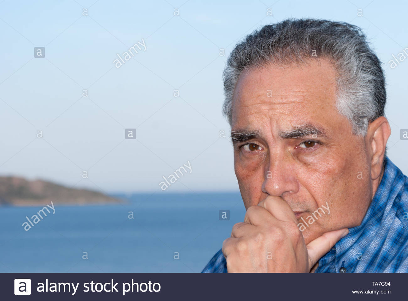 Man thinking and contemplating - Stock Image