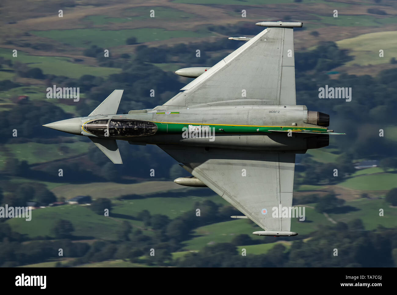 RAF Eurofighter Typhoon flying low level through the Mach Loop In Wales, UK Stock Photo