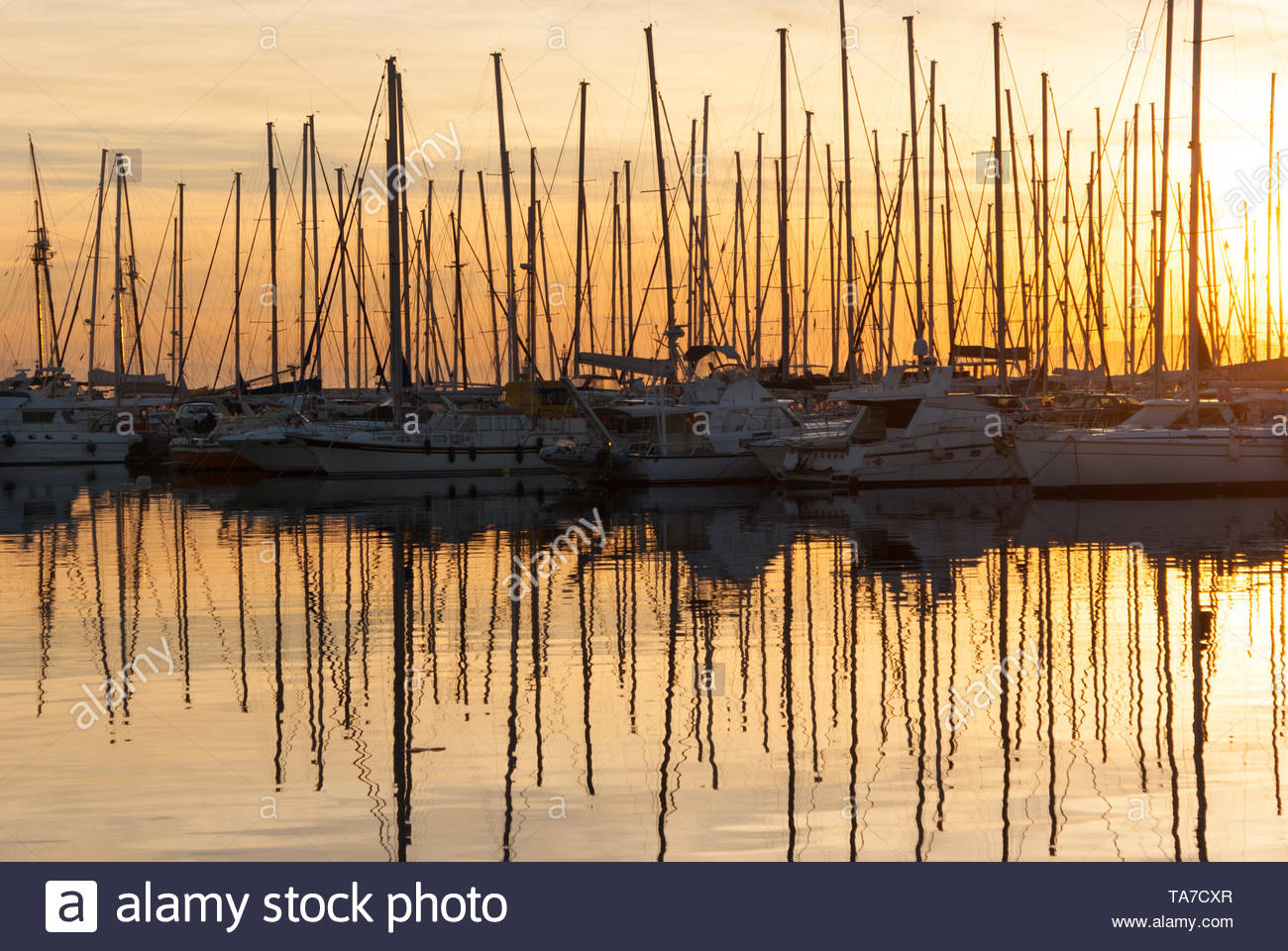 Docked Sailboats at Marina in Alimos, Athens, Greece during the sunset Stock Photo