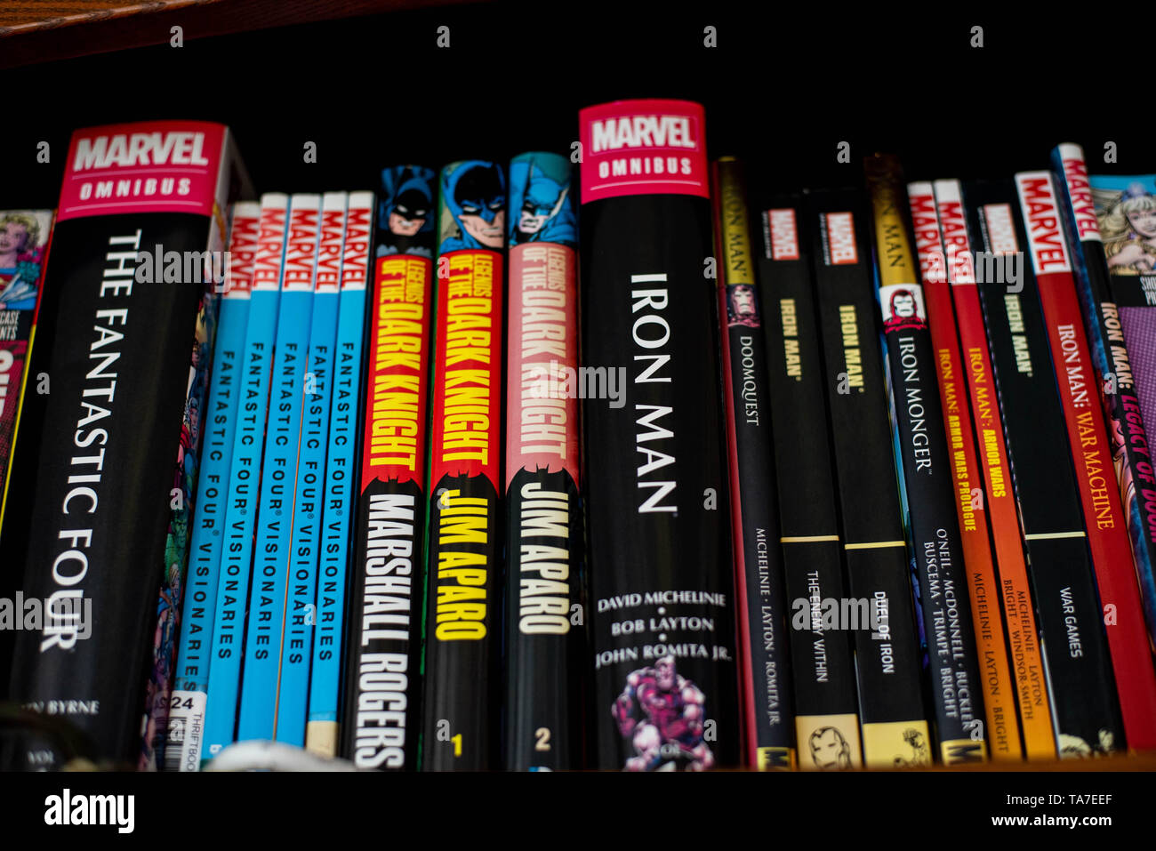 Comic book collections sit on a shelf - Stock Image