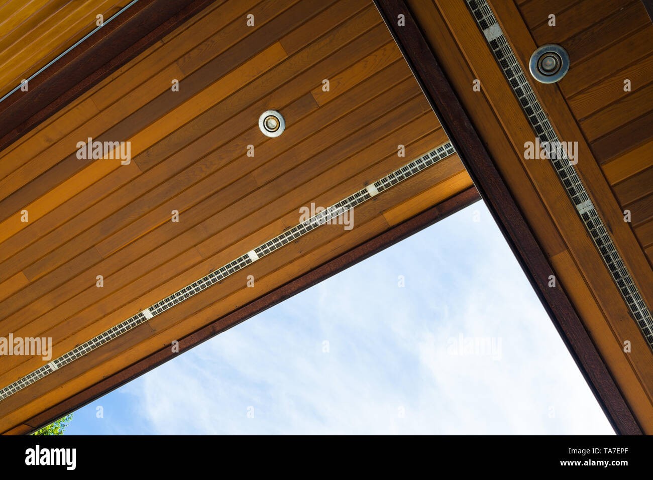 Abstract image of overlapping roof soffits with cedar strips and ventillation on a waterfront property on the Sunshine Coast of British Columbia Canad - Stock Image