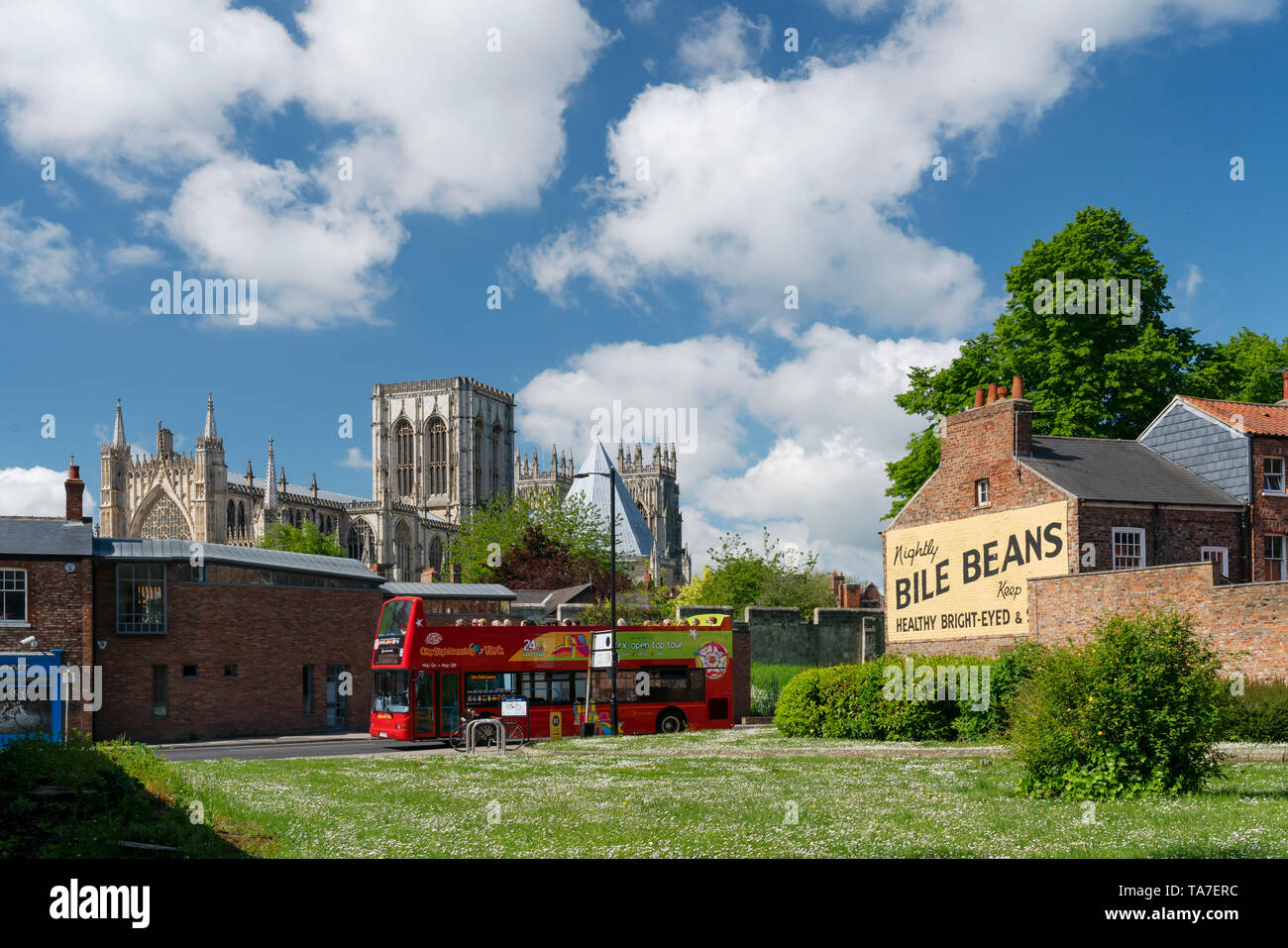 York Minster and the Bile Beans Ghost sign at Lord Mayors Walk, just outside the York city Bar Walls, North Yorkshire, UK. - Stock Image
