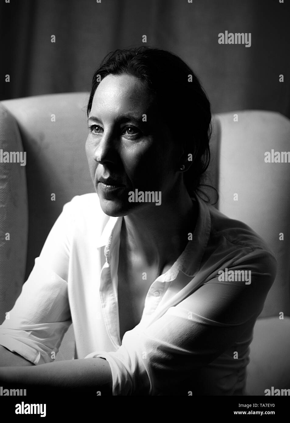 woman in an armchair - Stock Image