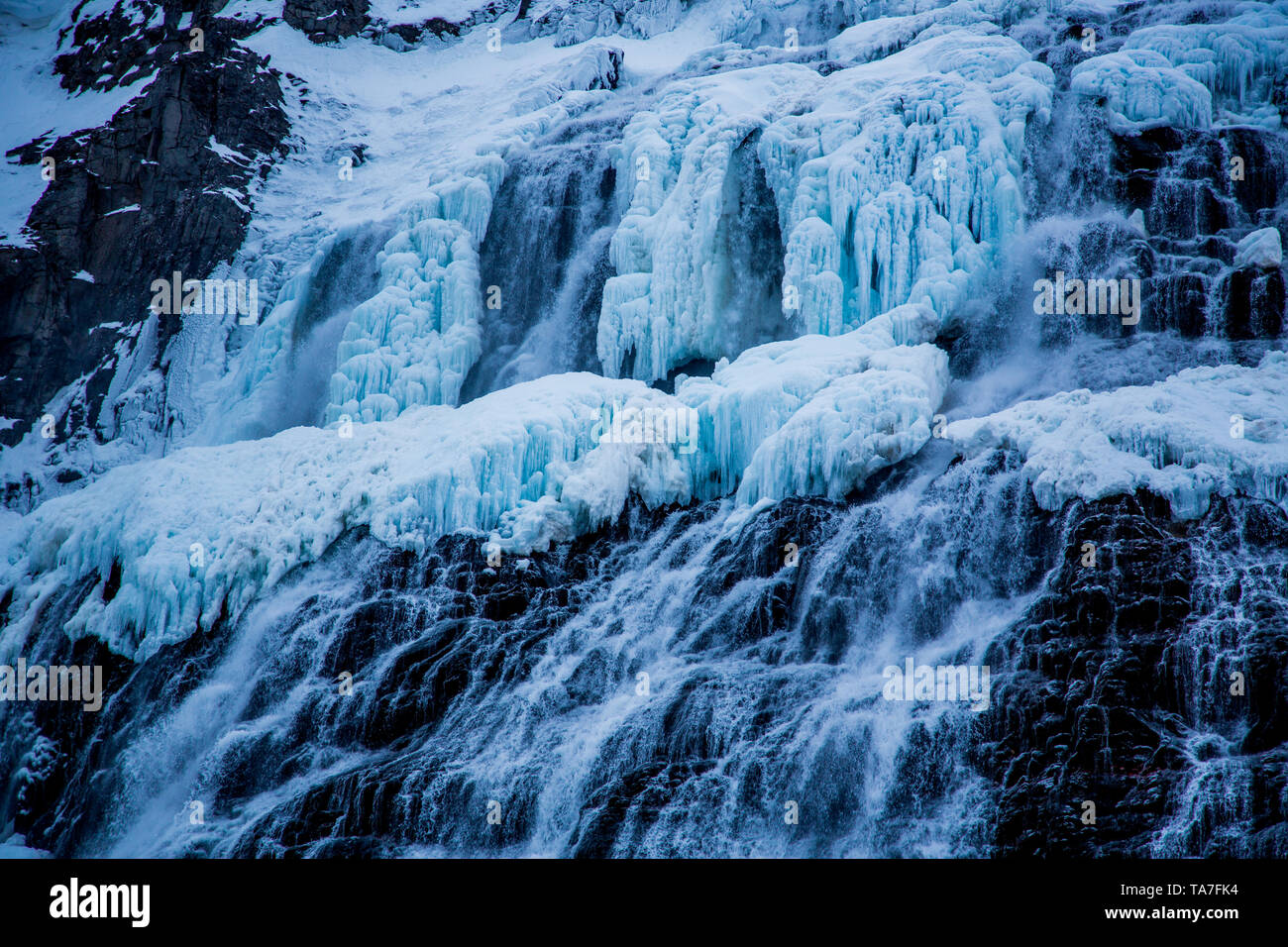Dynjandi waterfall in winter with frozen water and fog effect - Stock Image