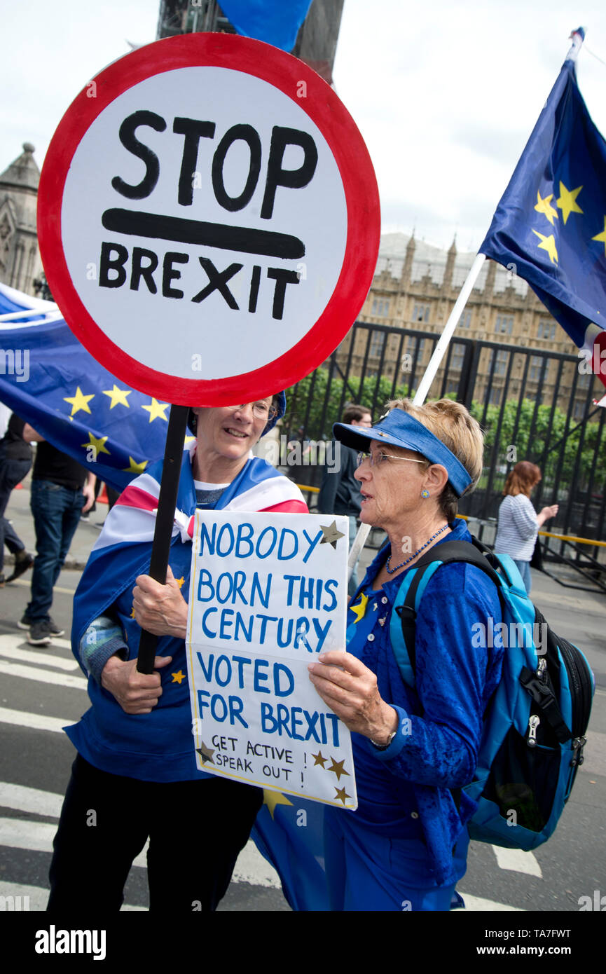 Westminster. Opposite Houses of Parliament May 22nd 2019. Protest to stop Brexit by Remainers. One woman holds a sign saying 'Stop Brexit' and another Stock Photo