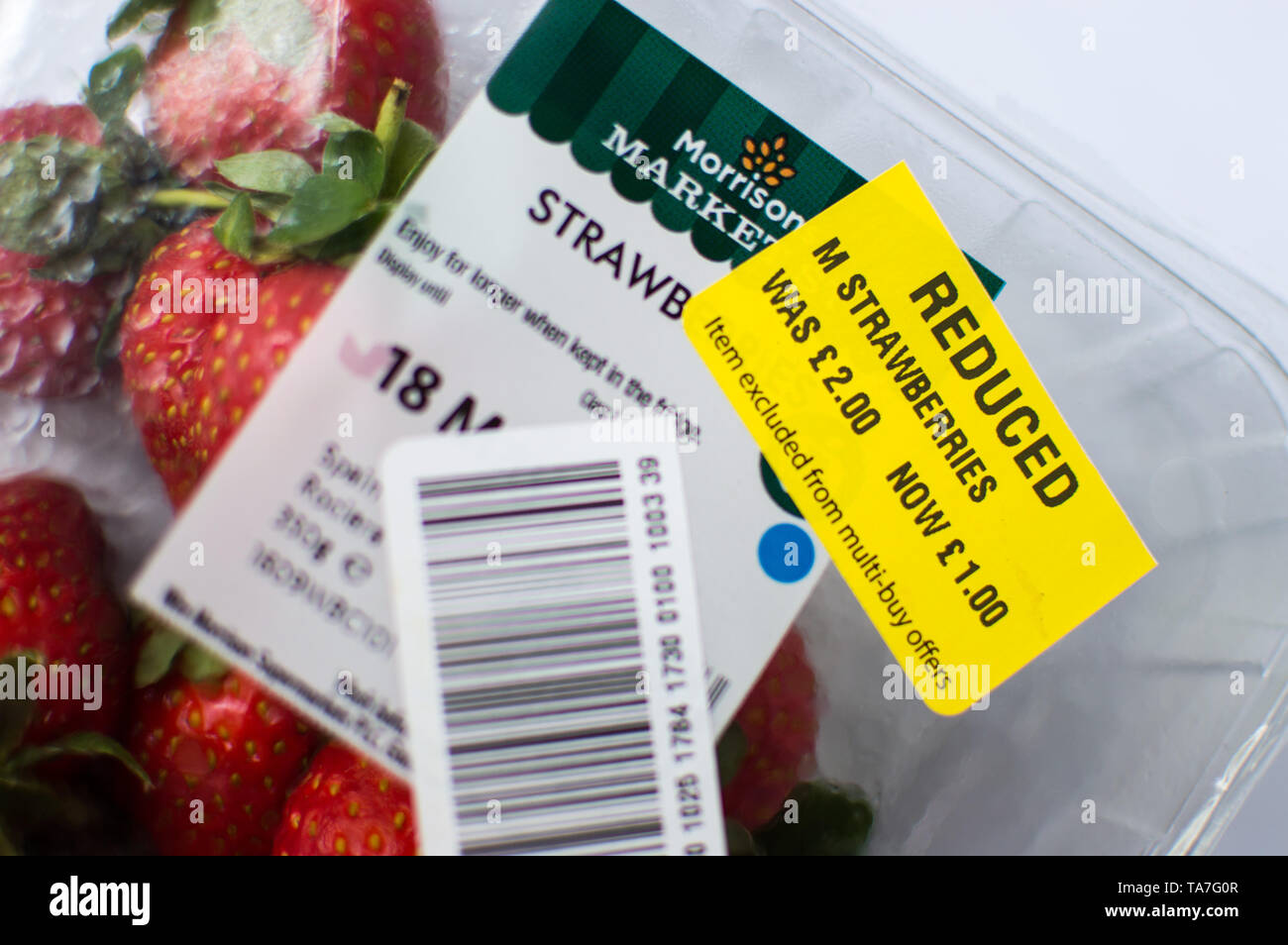 Yellow sticker reduced fruit in Morrisons supermarket - Stock Image