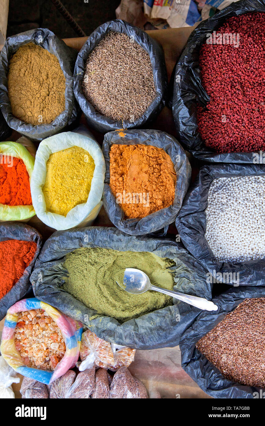In the highlands north of Quit, Ecuador. Bags of colorful spices in Otavalo market town. - Stock Image