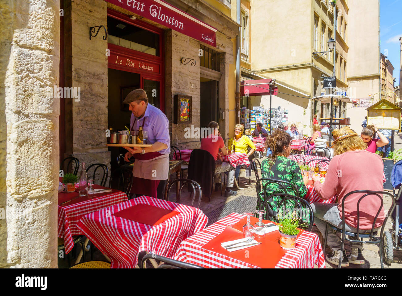 Lyon, France - May 10, 2019: Street and cafe scene, with locals and visitors, in Old Lyon, France - Stock Image