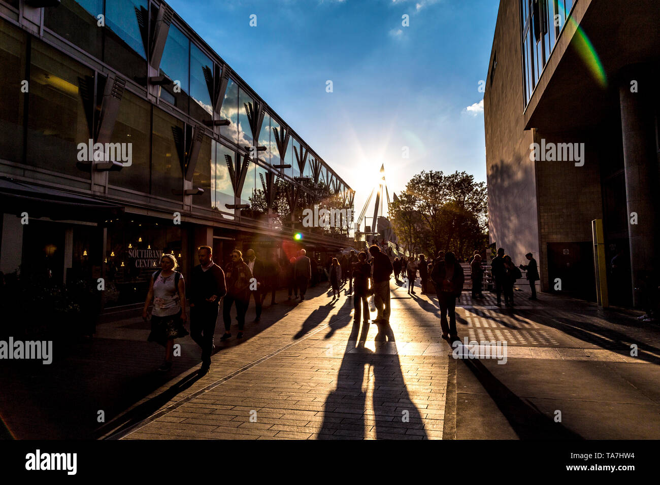Southbank at sunset, people walking by Southbank Centre, London, UK - Stock Image