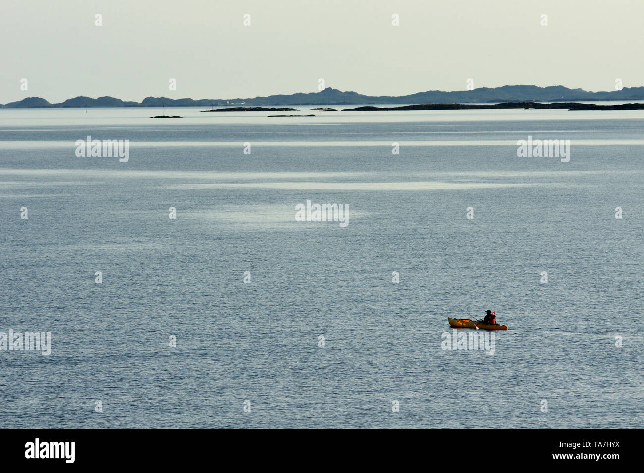 a kayak is paddled onto the sea in the polar circle Stock Photo