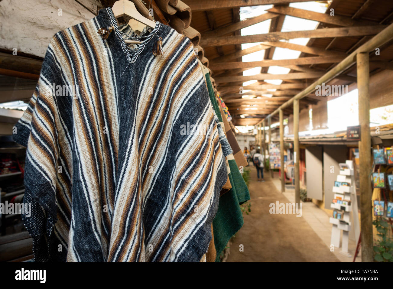 Traditional Chilean coat for sale in the market - Stock Image