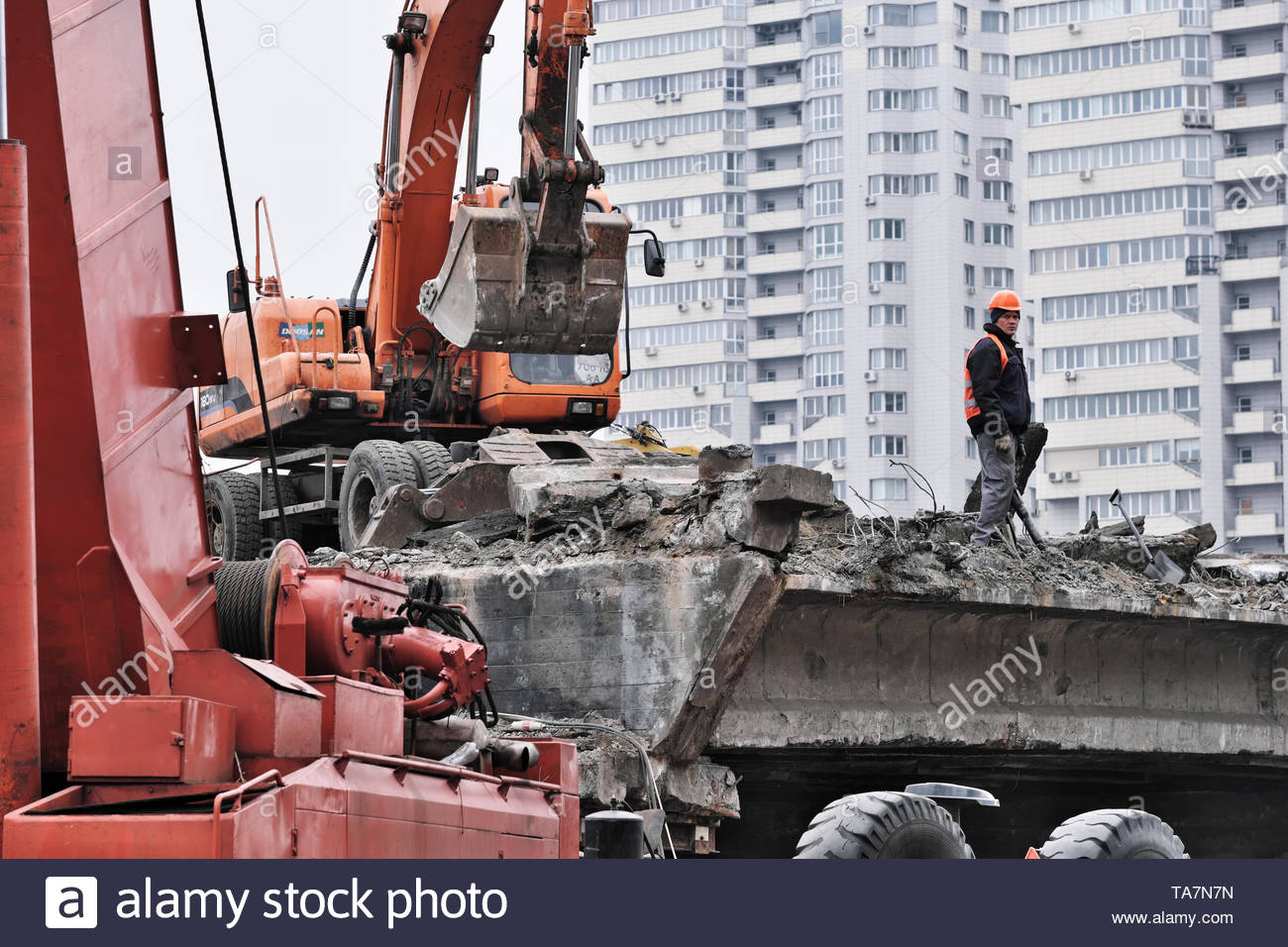 Dismantling of the old emergency Shuliavsky bridge in Kiev, Ukraine on March 21, 2019 dismantling the main supporting structures and removing the pave - Stock Image