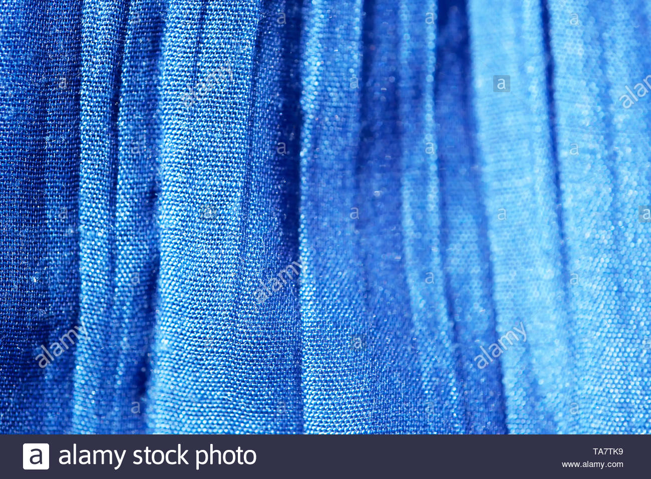 Blue background of fabric weaving cotton threads close-up macro shot - Stock Image