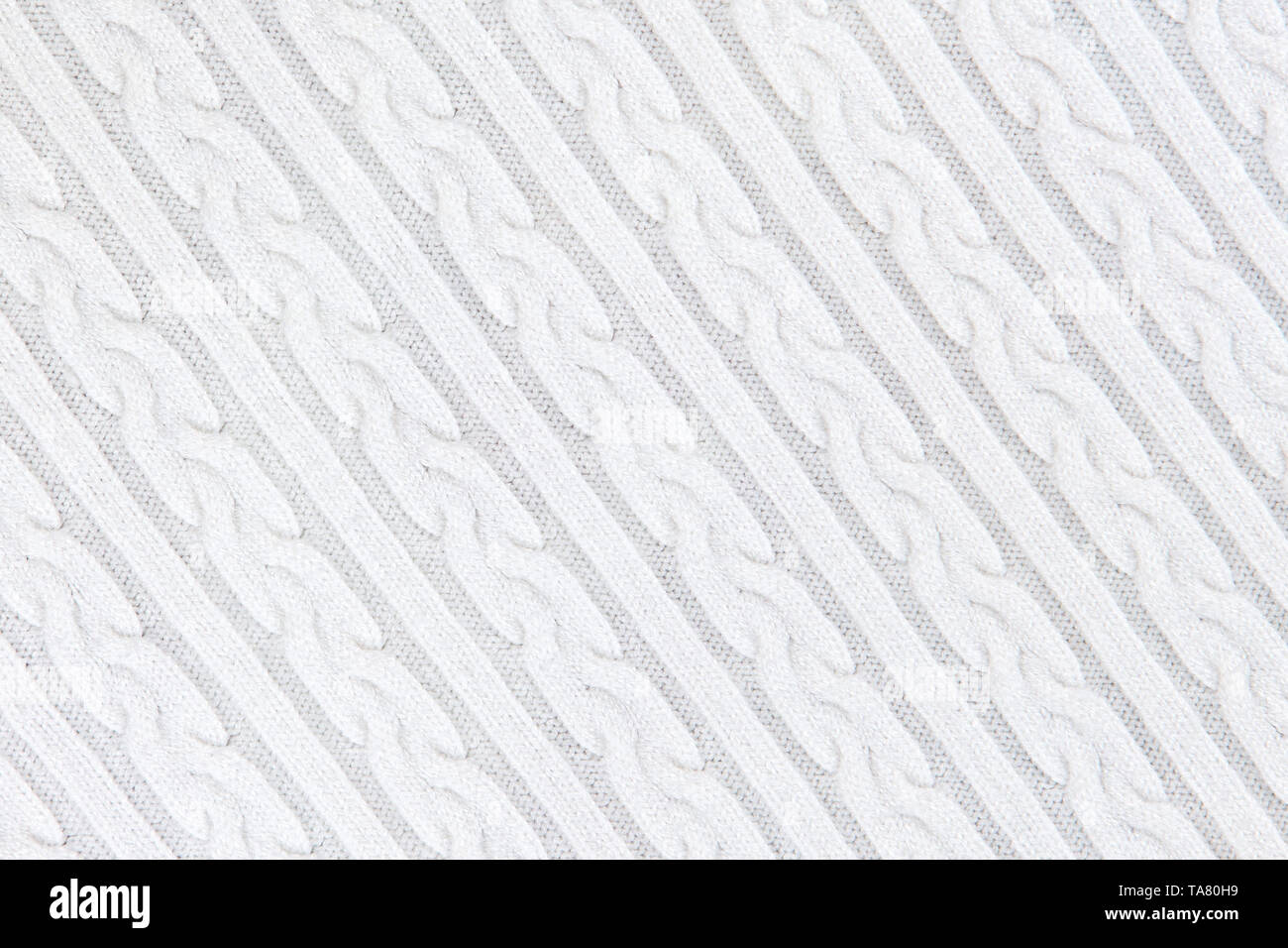 Knitwear Fabric Texture with Pigtails and stripes. Repeating Machine Knitting Texture of Sweater. White Knitted Background. Diagonal composition. - Stock Image