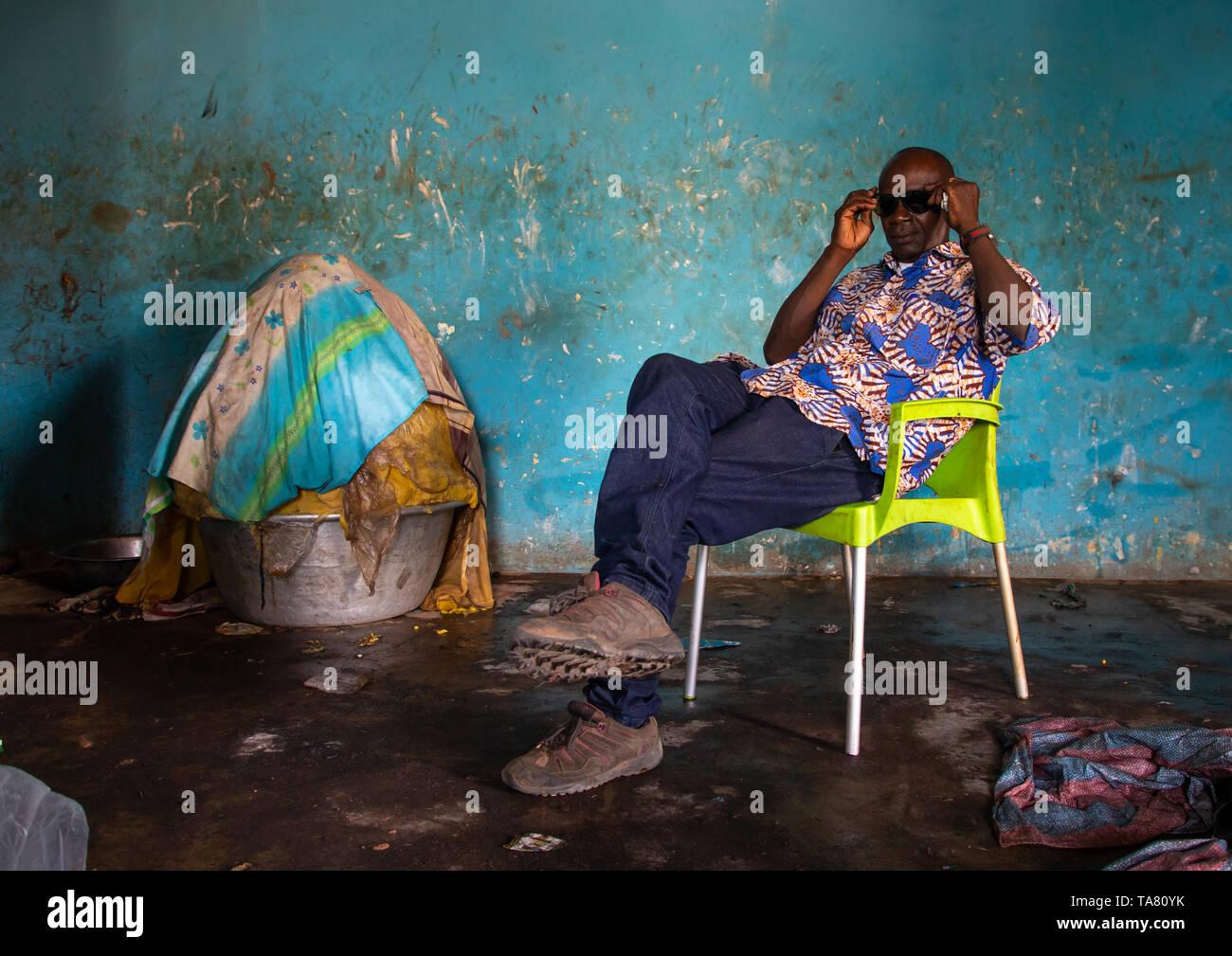 Senufo man in a shea butter or karite factory, Savanes district, Tcheregnimin, Ivory Coast Stock Photo