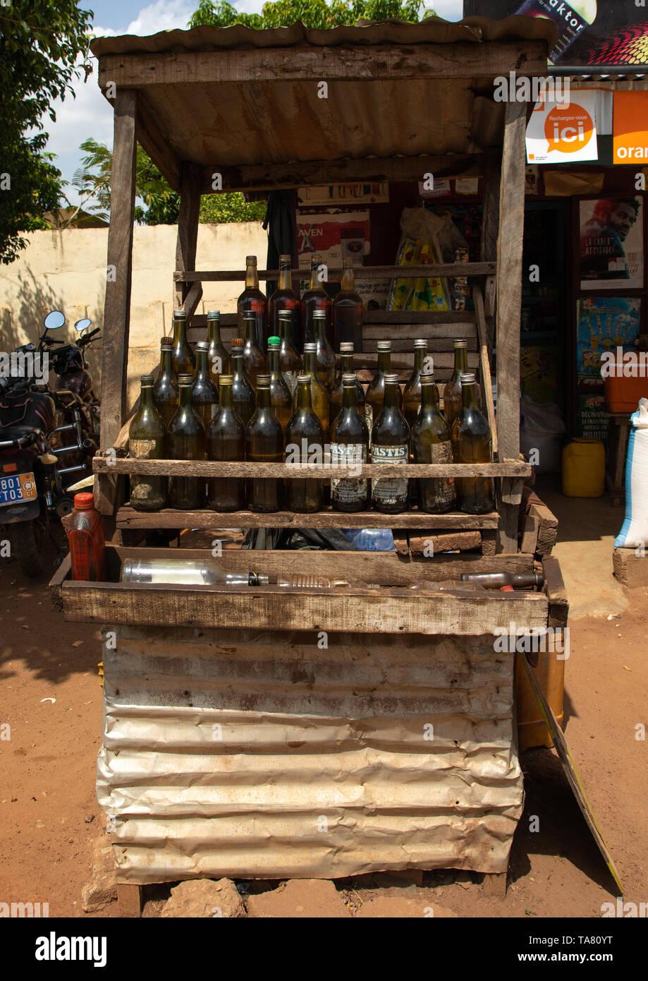 African gas station selling gasoline in bottles along the road, Poro region, Korhogo, Ivory Coast Stock Photo