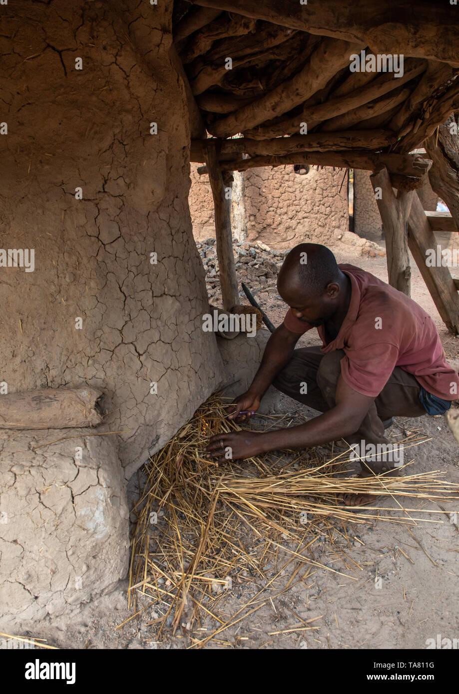 Senufo blacksmith preparing the fire, Poro region, Koni, Ivory Coast Stock Photo