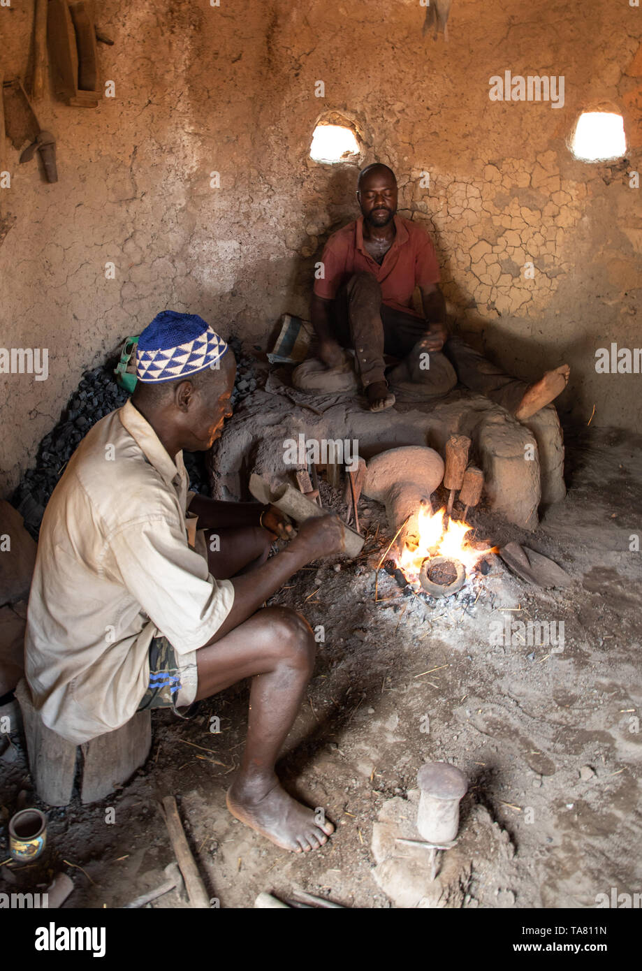 Senufo blacksmith working in his workshop, Poro region, Koni, Ivory Coast Stock Photo