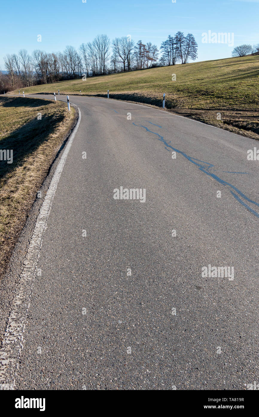 Gray road in the middle of the German countryside - Stock Image