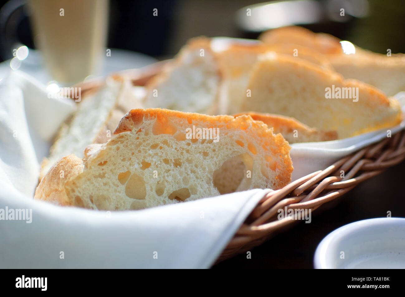 Toast bread in the basket on the table in caffe. Breakfast concept Stock Photo