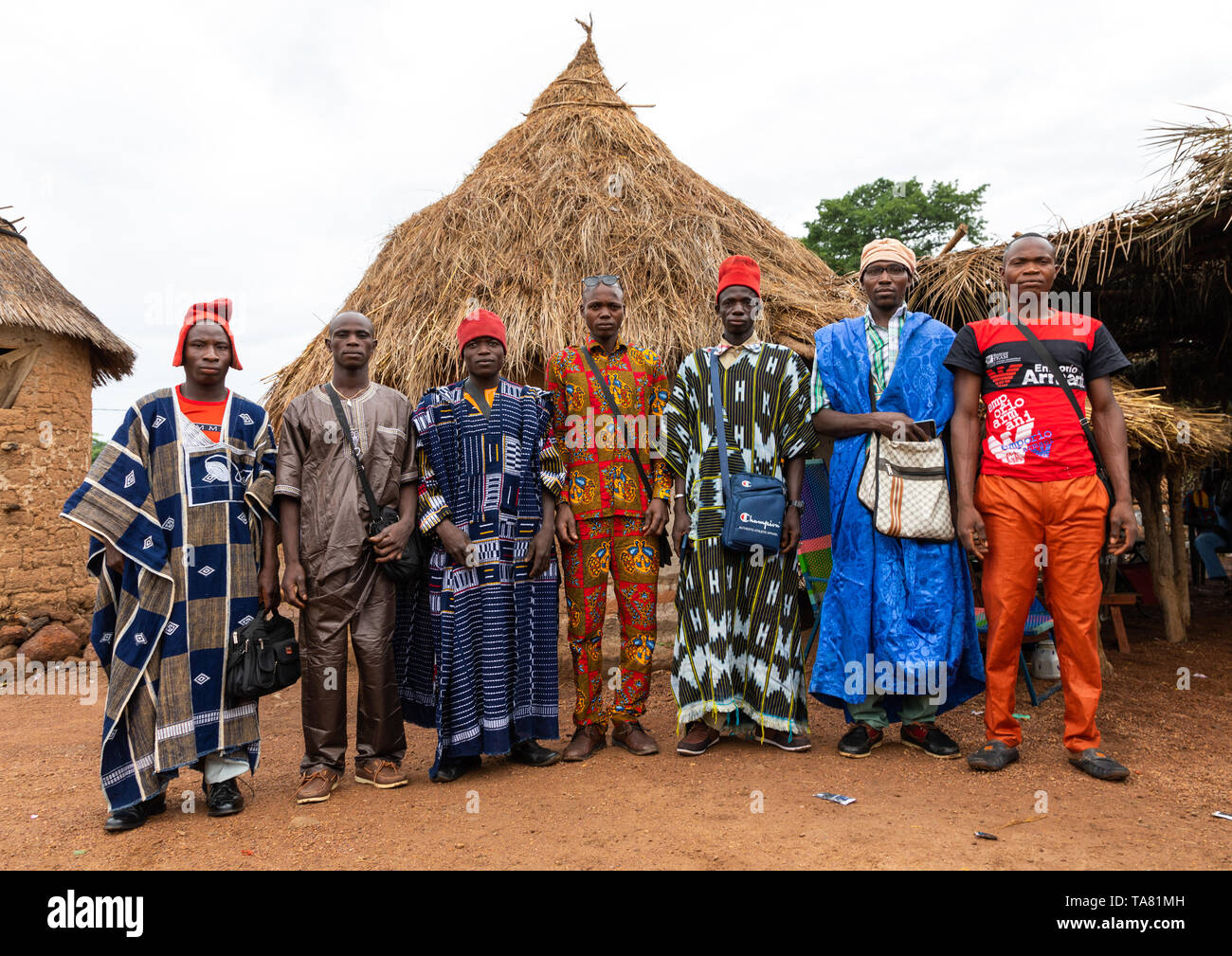 Young men attending the Poro society age-grade initiation in Senufo tribe during a ceremony, Savanes district, Ndara, Ivory Coast Stock Photo