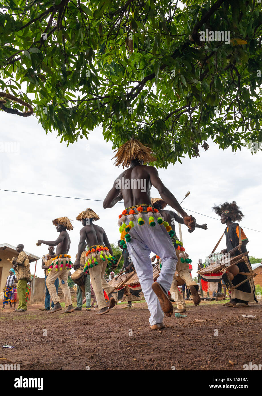 Senufo shirtless man dancing the Ngoro during a ceremony, Savanes district, Ndara, Ivory Coast Stock Photo