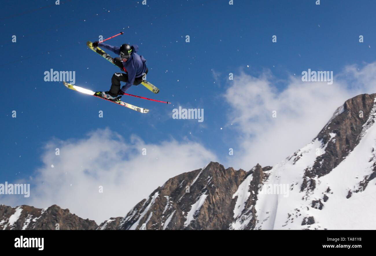 skier jumping on a snow park in Austrian alps - Stock Image